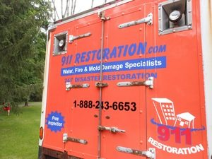 Water Damage Dorothy Box Truck Rear At Residential Job Location
