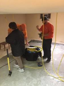 Water Damage Restoration Technicians Working