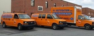 Water Damage Restoration Vehicles On Job Site