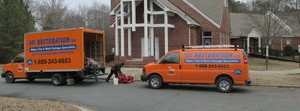 Mold and Water Damage Restoration Van At Residential Job Site
